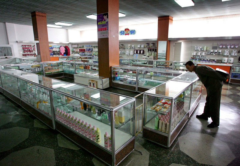 . A North Korean man looks at toiletry articles at a department store in North Korea\'s capital Pyongyang on October 17, 2005. Chinese currency and U.S. dollars are being used more widely than ever in North Korea instead of the country\'s own money. The use of dollars and Chinese yuan, or renminbi, has accelerated since a revaluation of the North Korean won in 2009 wiped out the savings of millions of people, said experts on the country, defectors and Chinese border traders.   REUTERS/Reinhard Krause