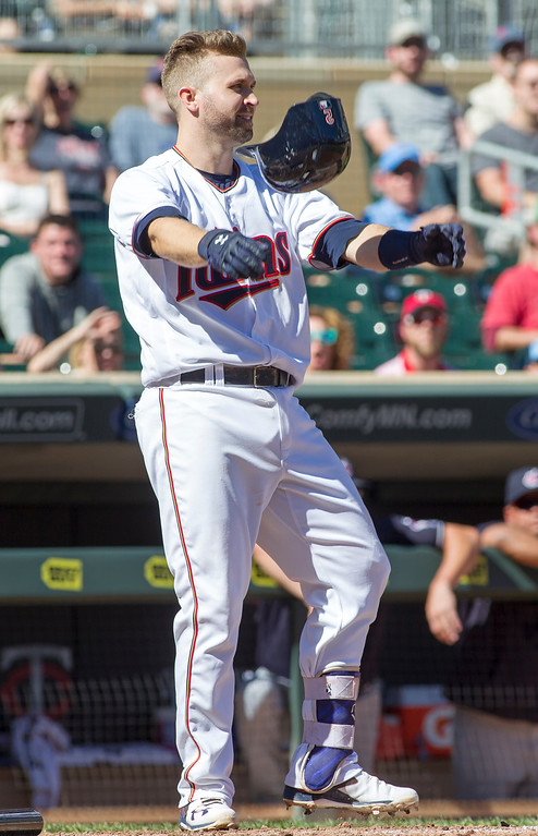 . Minnesota Twins\' Brian Dozier (2) reacts after being called out on strikes to end the fourth inning of a baseball game against the Cleveland Indians, Sunday, Sept. 11, 2016, in Minneapolis. (AP Photo/Paul Battaglia)