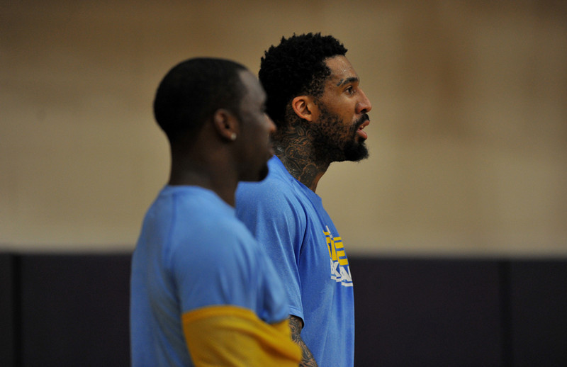 . Wilson Chandler, right, and Ty Lawson of Denver Nuggets are in the team practice for the 1st round of playoff game against Golden State Warriors at Pepsi Center. Denver. Denver, Colorado. April 19, 2013. (Photo By Hyoung Chang/The Denver Post)