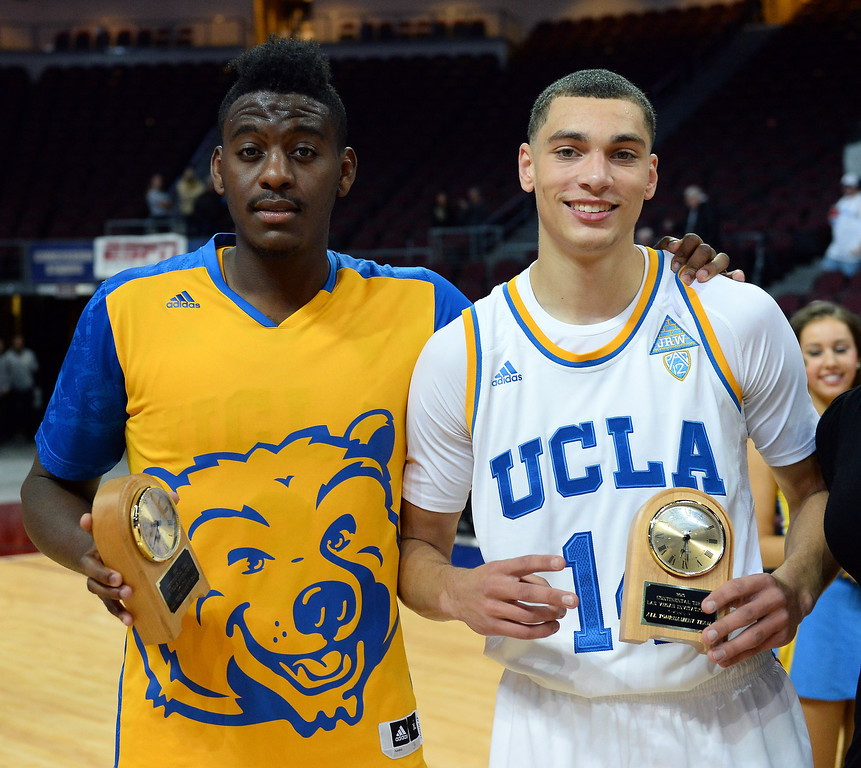. Jordan Adams #3 and Zach LaVine #12 of the UCLA Bruins hold all-tournament team awards after the Bruins defeated the Northwestern Wildcats 95-79 during the Continental Tire Las Vegas Invitational at the Orleans Arena on November 29, 2013 in Las Vegas, Nevada.  (Photo by Ethan Miller/Getty Images)
