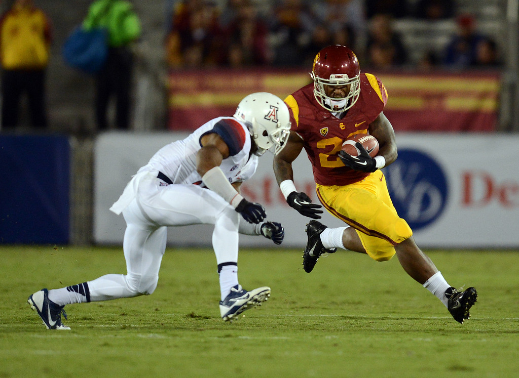 . USC\'s  Tre Madden #23 runs up field during their game against Arizona at the Los Angeles Memorial Coliseum Thursday, October 10, 2013. (Photo by Hans Gutknecht/Los Angeles Daily News)
