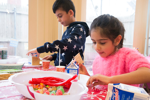 12/27/19 Wesley Bunnell | StaffrrGingerbread house making took place on Friday afternoon at the New Britain Youth Museum in New Britain. Fahad Akberzai, age 7, and his sister Hira, age 5, work on their houses.