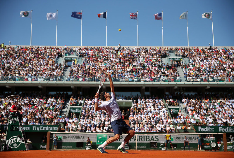 . Roger Federer of Switzerland serves in his Men\'s Singles quarter final match against Jo-Wilfried Tsonga of France during day ten of the French Open at Roland Garros on June 4, 2013 in Paris, France.  (Photo by Matthew Stockman/Getty Images)