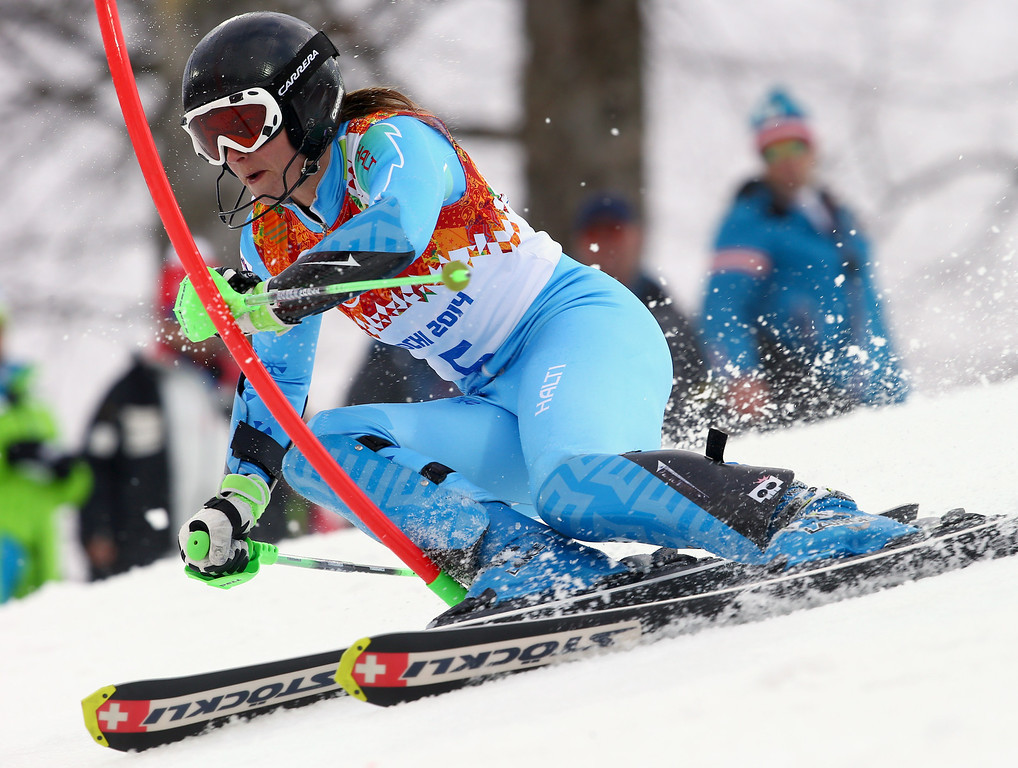. Slovenia\'s Tina Maze skis past a gate in the first run of the women\'s slalom at the Sochi 2014 Winter Olympics, Friday, Feb. 21, 2014, in Krasnaya Polyana, Russia. (AP Photo/Alessandro Trovati)