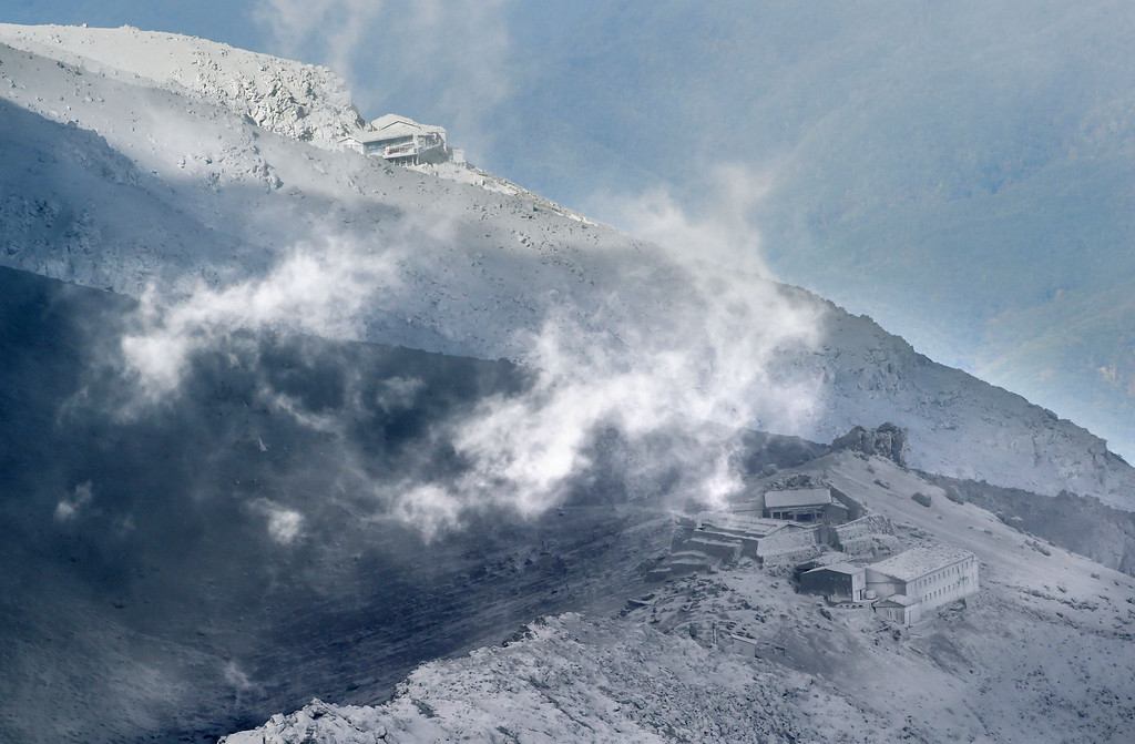 . The peak area of Mount Ontake is engulfed by volcanic gases in central Japan Tuesday afternoon, Sept. 30, 2014. Increased seismic activity raised concern Tuesday about the possibility of another eruption at the Japanese volcano where dozens of people were killed by Saturday\'s initial eruption, forcing rescuers to suspend plans to try to recover at least two dozen bodies still near the summit. (AP Photo/Kyodo News)