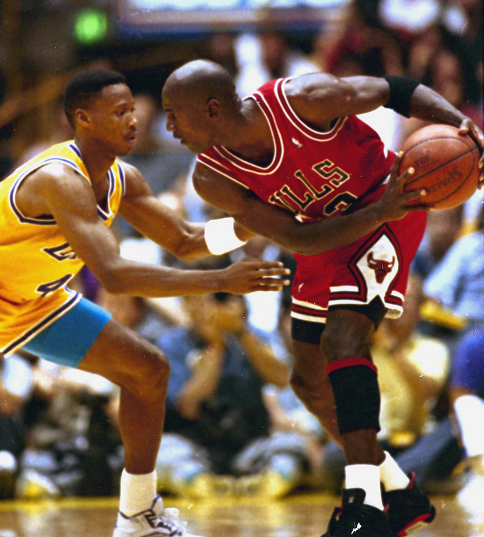 . Chicago Bulls\' Michael Jordan, right, keeps the ball away from Los Angeles Lakers\' Byron Scott during first half action in game four of the NBA finals at the Forum in Inglewood, Calif., June 9, 1991.  (AP Photo/Eric Risberg)