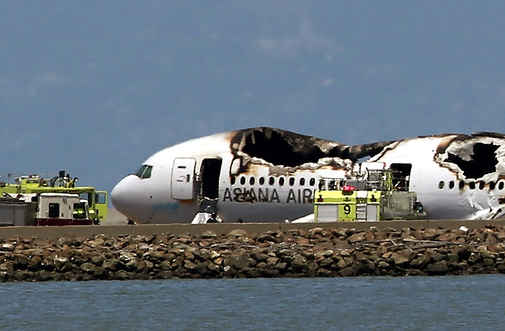 . A Boeing 777 airplane lies burned on the runway after it crashed landed at San Francisco International Airport July 6, 2013 in San Francisco, California.  passenger aircraft from Asiana Airlines coming from Seoul, South Korea crashed landed while on it\'s landing decent.  (Photo by Justin Sullivan/Getty Images)