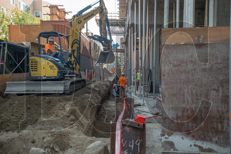 Westech Construction employees work on utility excavation at the Canvas project site. (Josh Kulla/DJC)