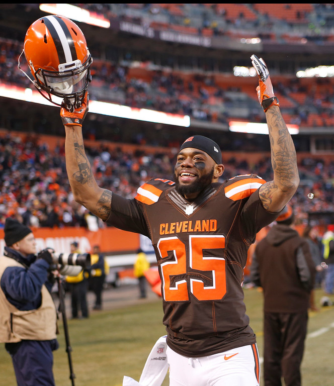 . Cleveland Browns running back George Atkinson (25) celebrates after the Browns defeated the San Diego Chargers 20-17 in an NFL football game, Saturday, Dec. 24, 2016, in Cleveland. (AP Photo/Ron Schwane)