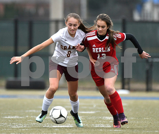 11/18/2017 Mike Orazzi | Staff Granby Memorial's Rachel Kadis (8)) and Berlin's Taylor Edman (13) during the Class M Final at Municipal Stadium in Waterbury Saturday. Granby won 3-0.