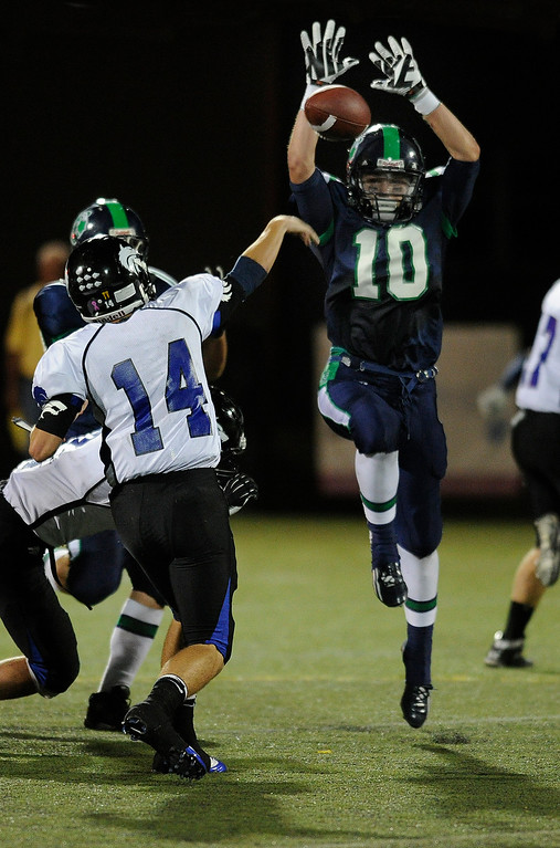 . HIGHLANDS RANCH, CO. - SEPTEMBER 13: Wolves\' quarterback Tyler Smith (14) threw under pressure from Grizzlies\' linebacker Clay Johnson (10) in the second half. The ThunderRidge High School football team defeated Grandview 21-7 at Shea Stadium Friday night, September 13, 2013.  Photo By Karl Gehring/The Denver Post