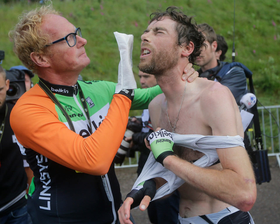 . A soigneur washes the face of Netherland\'s Laurens ten Dam after the tenth stage of the Tour de France cycling race over 161.5 kilometers (100.4 miles) with start in Mulhouse and finish in La Planche des Belles Filles, France, Monday, July 14, 2014. (AP Photo/Laurent Cipriani)