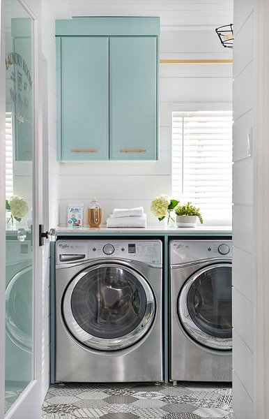 Laundry-room-with-turquoise-cabinets-cement-tile-flooring-and-brass-hardware.-Laundryroom-turquoisecabinet-Turquoise-brasshardware-hardware.jpg