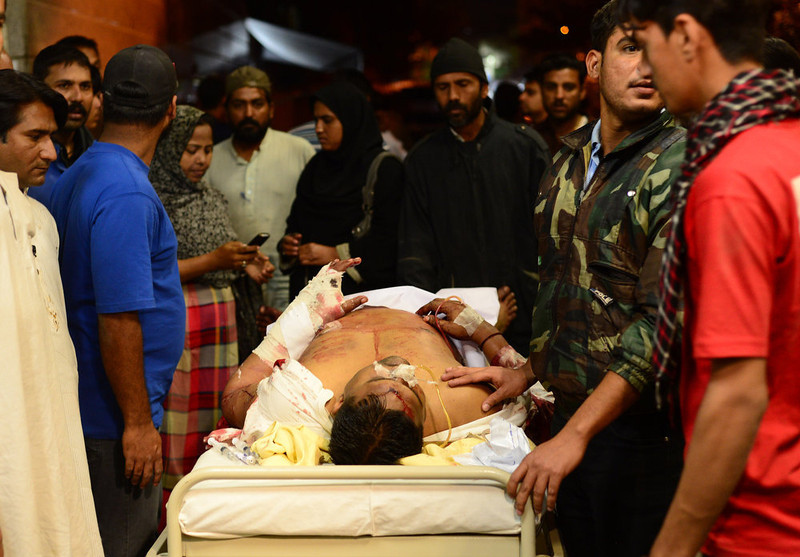. Rescuers evacuate an injured bomb blast victim after an explosion damaged two residential buildings in Karachi on March 3, 2013. A bomb attack in Pakistan\'s largest city Karachi on Sunday killed at least 23 people, including women and children, and wounded 50 others, police said. RIZWAN TABASSUM/AFP/Getty Images