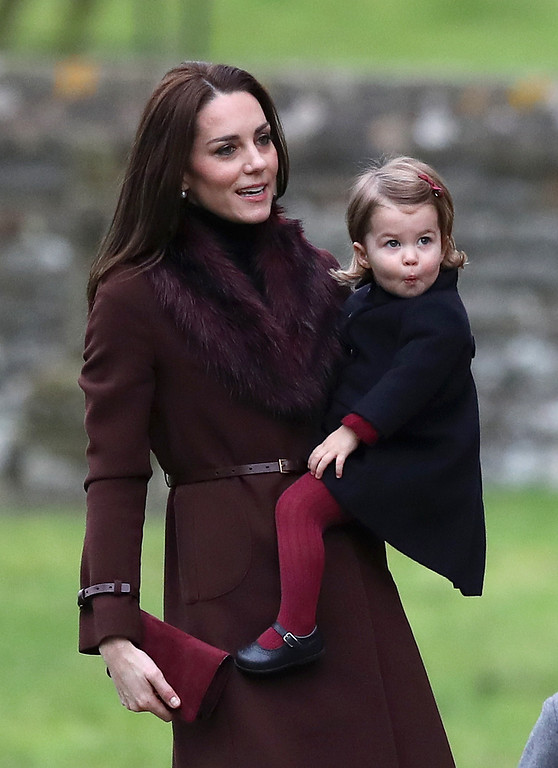 . Kate, the Duchess of Cambridge and her daughter Princess Charlotte arrive for the morning Christmas Day service at St Mark\'s Church in Englefield, England, on Sunday Dec. 25, 2016. A heavy cold is keeping Queen Elizabeth II from attending the traditional Christmas morning church service near her Sandringham estate in rural Norfolk, England. (Andrew Matthews/Pool via AP)