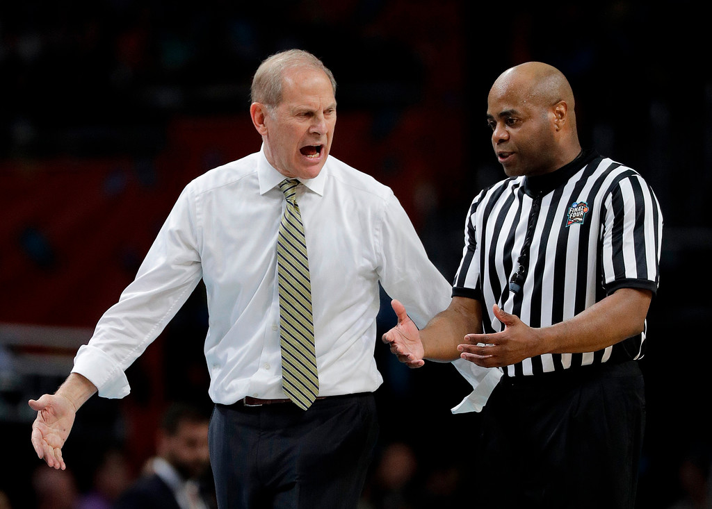 . Michigan head coach John Beilein argues a call with a referee during the first half in the championship game of the Final Four NCAA college basketball tournament against Villanova, Monday, April 2, 2018, in San Antonio. (AP Photo/David J. Phillip)