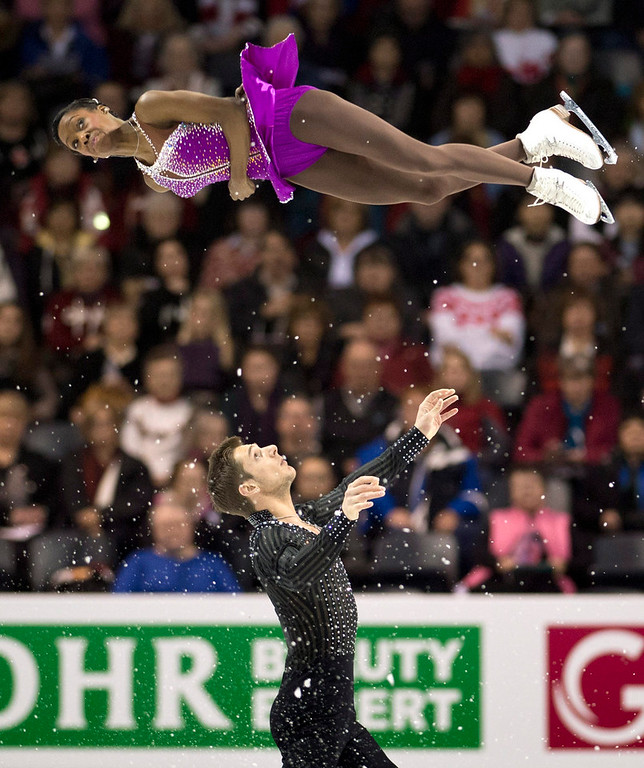 . France\'s Vanessa James is tossed in the air by her partner Morgan Cipres during the pairs short program at the World Figure Skating Championships in London, Ontario, on Wednesday, March 13, 2013. (AP Photo/The Canadian Press, Paul Chiasson)