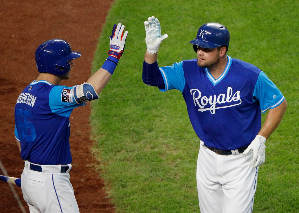 . Kansas City Royals\' Lucas Duda, right, celebrates with Ryan O\'Hearn (66) after hitting a solo home run during the sixth inning of a baseball game against the Cleveland Indians on Saturday, Aug. 25, 2018, in Kansas City, Mo. (AP Photo/Charlie Riedel)