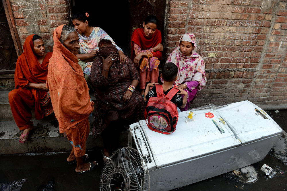 . Pakistani Christian\'s react as they sit outside burnt out home torched by Muslim demonstrators in Lahore on March 10, 2013. Christians demonstrated around Pakistan to protest after a Muslim mob torched more than 100 Christian homes following allegations of blasphemy. More than 3,000 Muslims rampaged through Joseph Colony, a Christian area of the eastern city of Lahore, on March 9 after allegations that a Christian had made derogatory remarks about the Prophet Mohammed three days earlier. Arif Ali/AFP/Getty Images