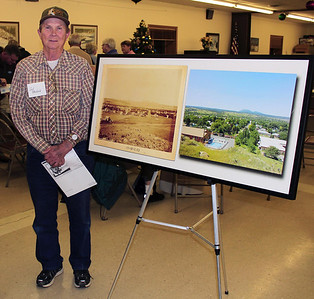 """A bit of additional excitement took place following the program when Cecil Whitlock was presented with a large framed """"then and now"""" photograph of Spearfish.  His raffle ticket won him the prized Paul Horsted item, which was among the many rare photos Horseth included in his book """"The Black Hills: Yesterday and Today.""""  Horsted donated two framed photographs of Spearfish, for which we are very grateful.  And our congratulations to Cecil Whitlock!"""