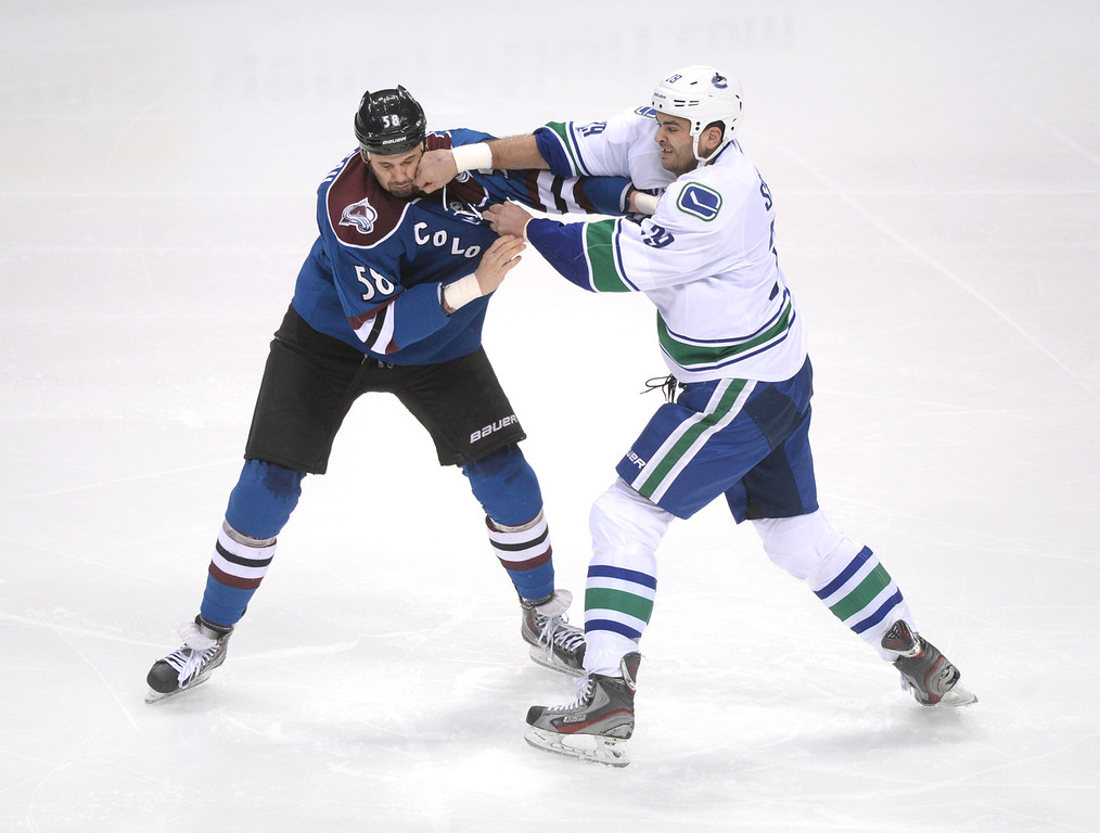 . Avs wing Patrick Bordeleau and Vancouver wing Tom Sestito exchanged punches in a fight in the second period. The Colorado Avalanche hosted the Vancouver Canucks Thursday night, March 27, 2014 at the Pepsi Center in Denver, Colorado. (Photo by Karl Gehring/The Denver Post)