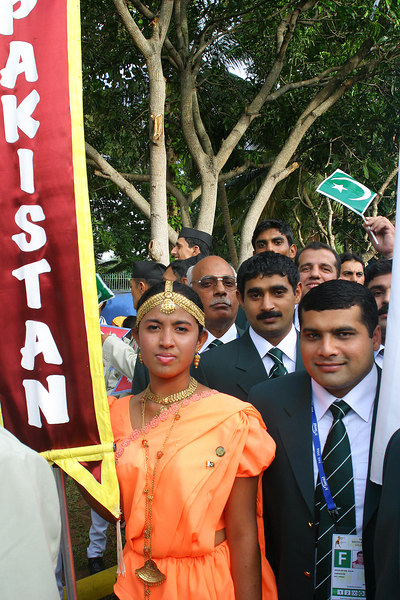 The Pakistan flag bearer on the right.  He won a gold medal at the Commonwealth Games.  We are still assembling outside the stadium.  The delegation leader kept trying to get us into military formation but it didn't seem to work too well.