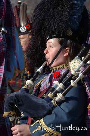 Piper in the pipe and drum band at the 2009 Remembrance Day Ceremony in Ottawa, Ontario.  © Rob Huntley