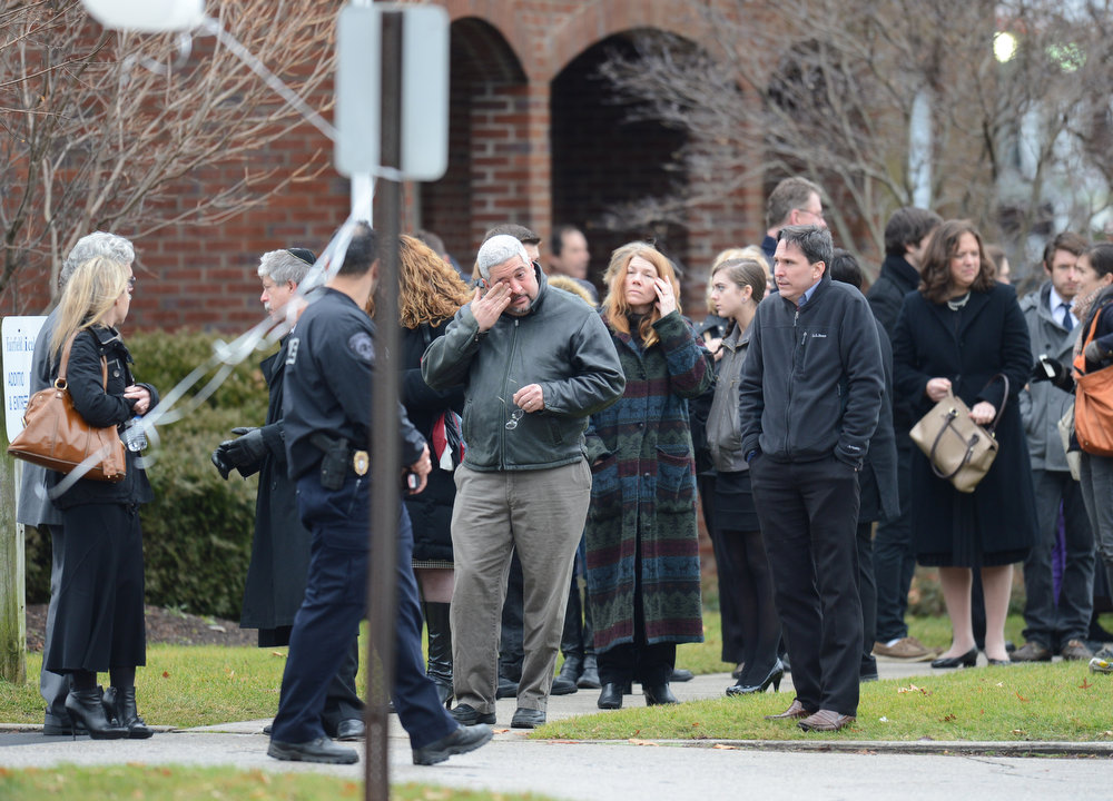 Description of . Mourners leave following the funeral of Noah Pozner December 17, 2012 at the Abraham L. Green and Son Funeral Home in Fairfield, Connecticut. Pozner, a six year-old Jewish boy who, along with 19 other classmates and 6 teachers was murdered by a lone gunman December 14 at the Sandy Hook Elementary School in Newtown, Connecticut.  AFP PHOTO / Don  EMMERT/AFP/Getty Images