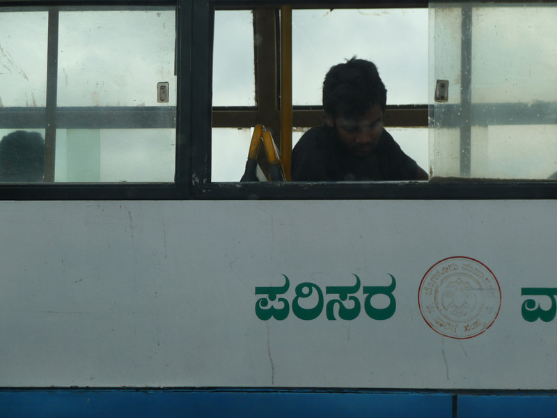 At a traffic light in Bangalore on the way from the airport.  He sat there staring down at the ground out the window through the whole light.  Wondered what was going on in his head.