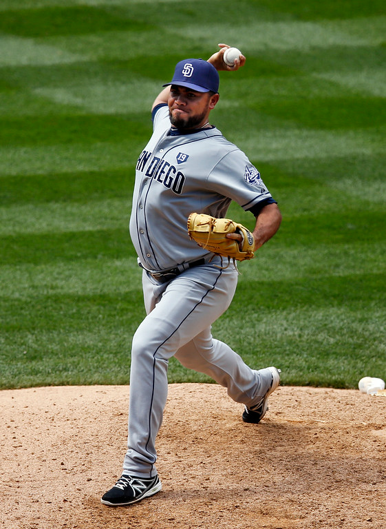 . San Diego Padres relief pitcher Joaquin Benoit throws to the plate against the Colorado Rockies during the eighth inning of a baseball game on Wednesday, July 9, 2014, in Denver. (AP Photo/Jack Dempsey)