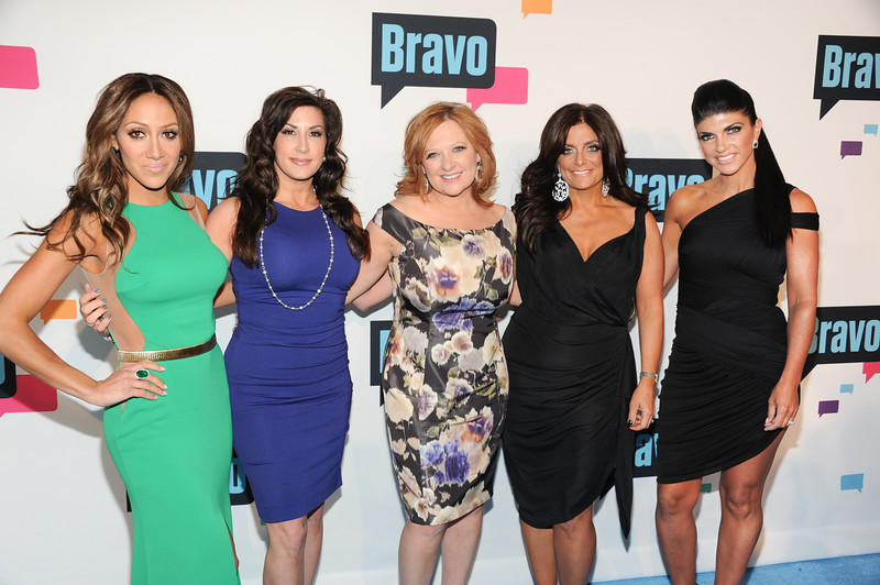 ". ""The Real Housewives of New Jersey\"" cast members, from left, Melissa Gorga, Jacqueline Laurita, Caroline Manzo, Kathy Wakile and Teresa Giudice attend the Bravo Network 2013 Upfront on Wednesday April 3, 2013 in New York. (Photo by Evan Agostini/Invision/AP)"