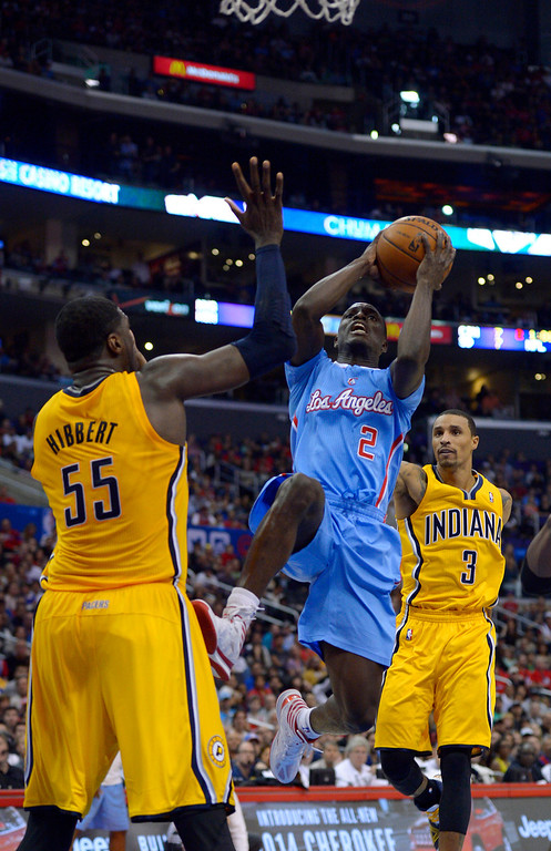 . Los Angeles Clippers guard Darren Collison, center, goes up for a shot as Indiana Pacers center Roy Hibbert, left, and guard George Hill defend during the second half of an NBA basketball game, Sunday, Dec. 1, 2013, in Los Angeles. (AP Photo/Mark J. Terrill)