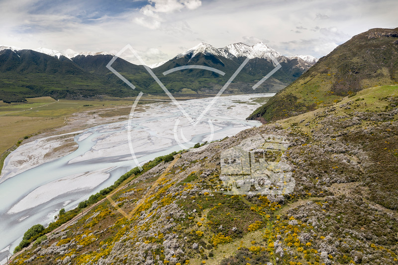 Aerial image with the Mt White Bridge and TranzAlpine Railway running along the Waimakariri River, through the Southern Alps of New Zealand