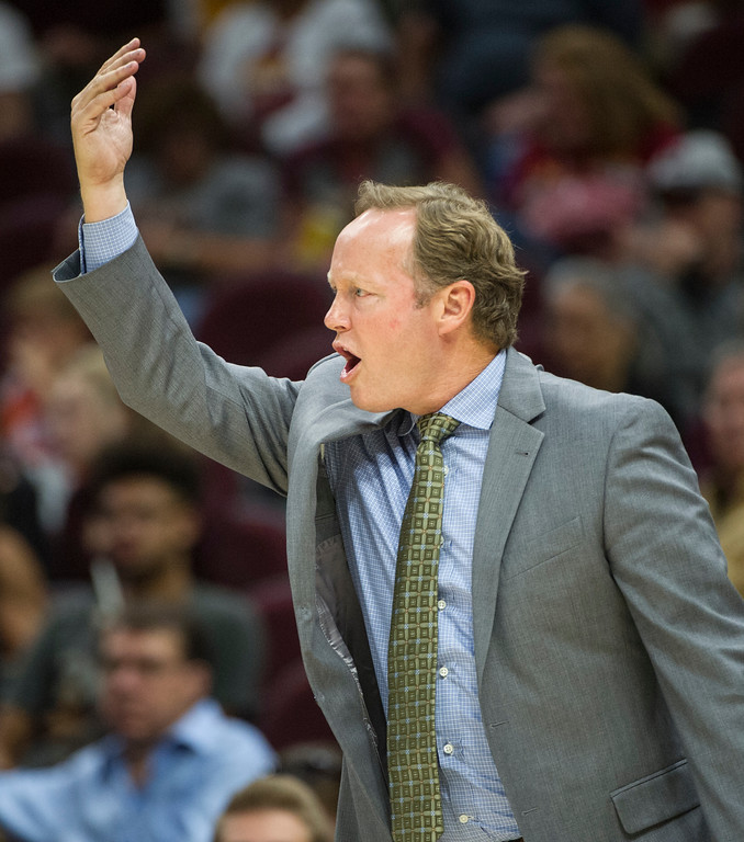 . Atlanta Hawks head coach Mike Budenholzer directs his team during the second half of an NBA pre-season basketball game against the Cleveland Cavaliers in Cleveland, Wednesday, Oct. 4, 2017. The Hawks won 109-93. (AP Photo/Phil Long)