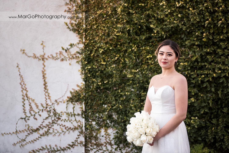 bridal portrait at green wall at Mt Hamilton GrandView Restaurant in San Jose