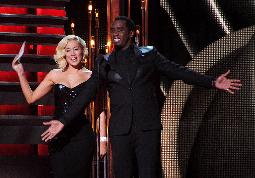 . From left, Kellie Pickler and Sean Combs speak onstage at The 47th Annual CMA Awards, on Wednesday, November 6, 2013 at Bridgestone Arena in Nashville, Tenn. (Photo by Frank Micelotta/Invision/AP Images)