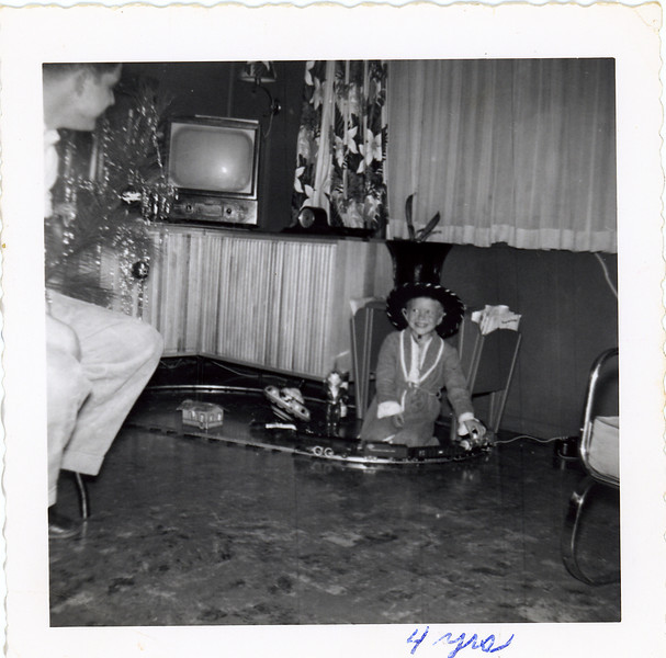 Circa:1953, Jay with his Christmas train set, see that sliding cabinet in the background, that same cabinet is at the cabin in 2012