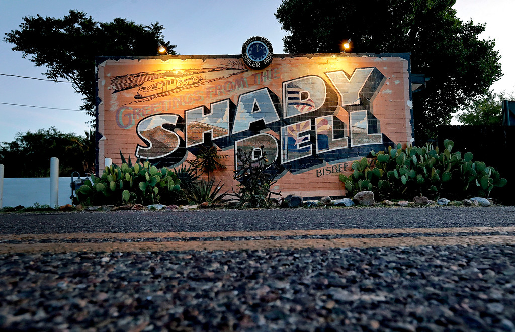 . The front office of the Shady Dell trailer court is illuminated at dawn, Wednesday, April 26, 2017, in Bisbee, Ariz. Founded in 1927 as the as the Thompson Motor Court and later renamed the Shady Dell in the 1950\'s, the rest haven nestled in the tiny mining town was a frequent stop for motorists during the golden age of American automobile travel and is a now an off-the-beaten-path destination for travelers. (AP Photo/Matt York)
