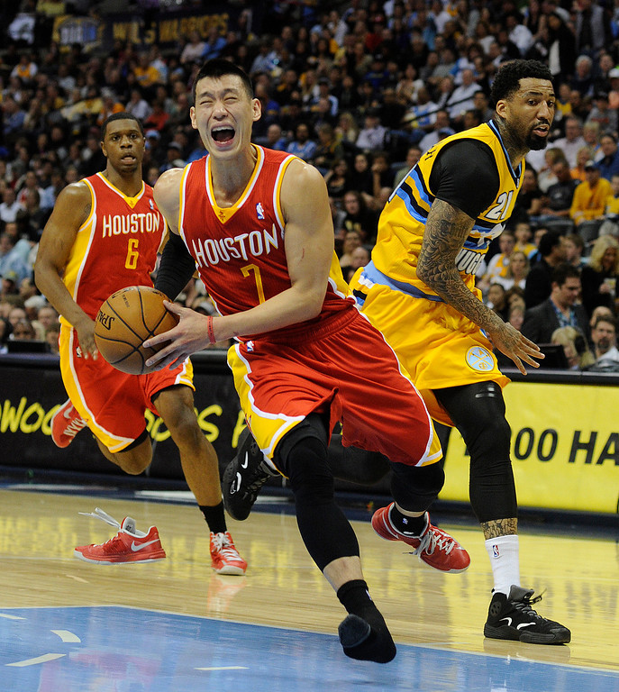 . DENVER, CO. - APRIL 6: Rockets guard Jeremy Lin ran out of his shoe driving to the basket in the first half. The Denver Nuggets hosted the Houston Rockets at the Pepsi Center Saturday night, April 6, 2013. Photo By Karl Gehring/The Denver Post)