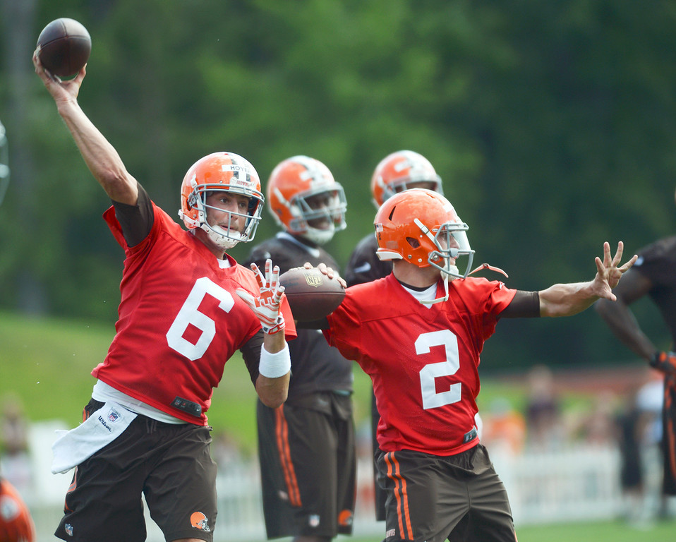 . Duncan Scott/DScott@News-Herald.com Quarterbacks Brian Hoyer, left, and Johnny Manziel drill side-by-side as the Cleveland Browns opened training camp on July 26 with their first practice at Browns headquarters in Berea.