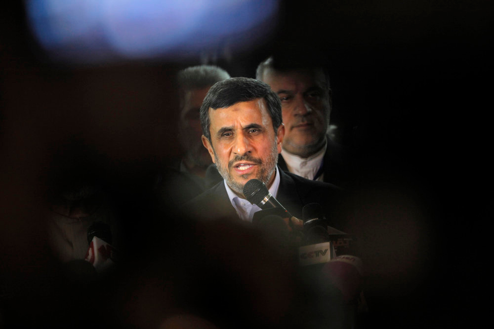 Description of . Iran's President Mahmoud Ahmadinejad, center, talks during a presser following his meeting with Grand Sheik Ahmed al-Tayeb, the head of Al-Azhar, the Sunni Muslim world's premier Islamic institution, not pictured, at Al Azhar headquarters in Cairo, Egypt, Tuesday, Feb. 5, 2013. Egypt's most prominent Muslim cleric, the sheik of Al-Azhar, has warned Iranian President Mahmoud Ahmadinejad against interfering in Arab Gulf countries or trying to spread Shiite influence. Ahmadinejad, on a landmark visit to Egypt on Tuesday, received an uneasy reception from Ahmed el-Tayeb at Al-Azhar, the Sunni Muslim world's foremost Islamic institution.(AP Photo/Amr Nabil)