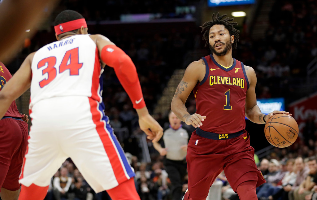 . Cleveland Cavaliers\' Derrick Rose (1) drives past Detroit Pistons\' Tobias Harris (34) in the first half of an NBA basketball game, Sunday, Jan. 28, 2018, in Cleveland. (AP Photo/Tony Dejak)