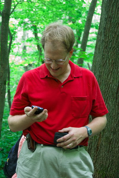 Bernie and his Blackbery   (Jul 05, 2007, 10:34am)  Even deep in the woods, hiking up Spruce Hill, Bernie has to stop to check his Blackberry.