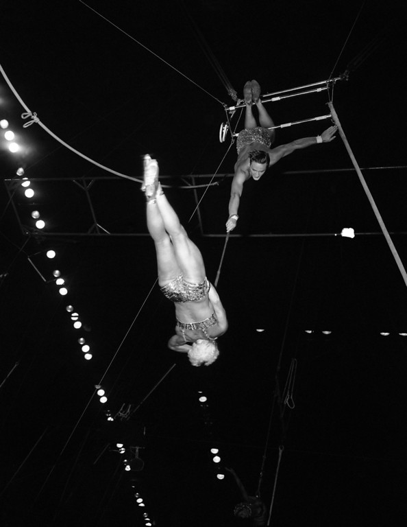 . �The Platos,� trapeze artists from Denmark, perform one of their spinning feats at the Ringling Brothers Barnum and Bailey show at Madison Square Garden, New York on April 2, 1953. The gentleman holds the rope while the lady makes like a pinwheel high above the arena floor. (AP Photo/Marty Lederhandler)