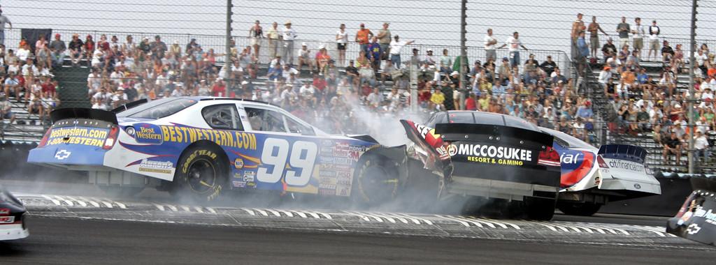 . Michael Waltrip (99) crashes into Boris Said, center, and Dale Jarrett in turn one during the NASCAR Zippo 200 Busch Series race at Watkins Glen International in Watkins Glen, N.Y., Saturday, Aug. 13, 2005. (AP Photo/David Duprey)
