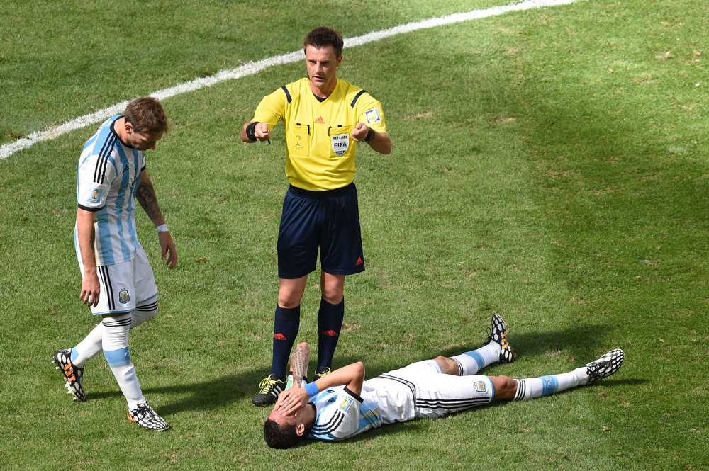 . Argentina\'s midfielder Angel Di Maria lies on the ground during a quarter-final football match between Argentina and Belgium at the Mane Garrincha National Stadium in Brasilia during the 2014 FIFA World Cup on July 5, 2014. (EVARISTO SA/AFP/Getty Images)