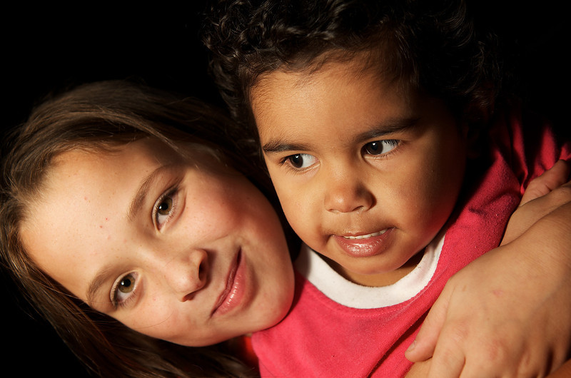 Aboriginal Australian Toddler and a Caucasian Girl cuddling
