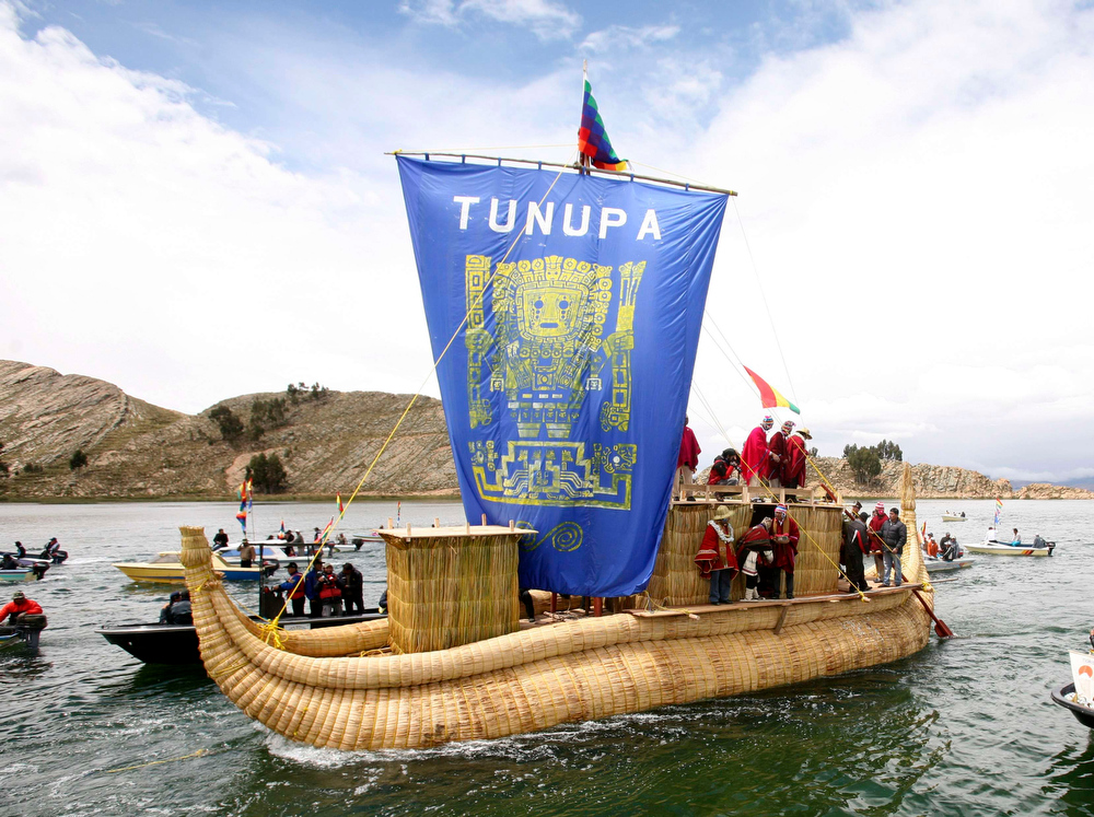 . The Tunupa ship is seen as Bolivian priests make offerings in Lake Titicaca, 74 km (46 miles) away from La Paz City, in La Paz December 16, 2012. Sunday marks the first of six days of celebrations to commemorate the end of the Mayan Calendar on December 21, which some believe to be the end of the world, that indigenous Bolivians regard as the change of an era. REUTERS/Gaston Brito