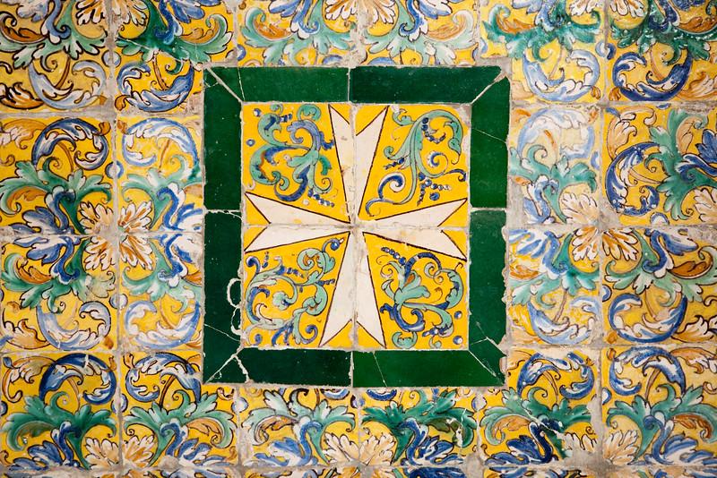 Cross on old glazed ceramic tiles, Fine Arts Museum, Seville, Spain