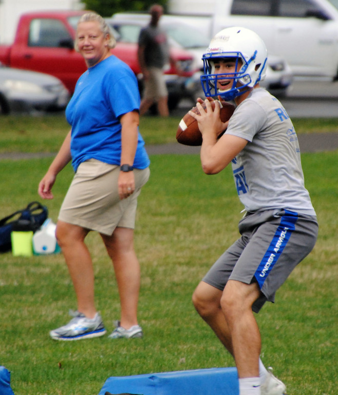 . Jon Behm - The Morning Journal<br> Sophomore quarterback Nick Buttari looks for an open reciever during Bay\'s first day of football practice on July 30.